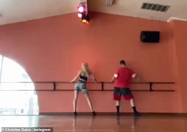 Working out: Later on Thursday, the reality star posted a short clip filmed from the other side of the dance studio as she and her instructor shook their backsides to Britney Spears
